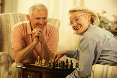 Men and women have fun playing chess
